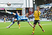 Jakob Ankersen of IFK Goteborg shoots a round kick next to Adam Lundqvist of IF Elfsborg during the Allsvenskan match between IF Elfsborg and IFK...