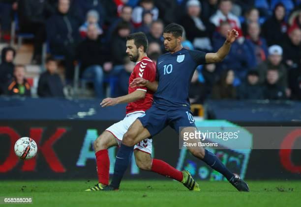 Jakob Blabjerg of Denmark and Ruben LoftusCheek of England battle for the ball during the U21 international friendly match between Denmark and...