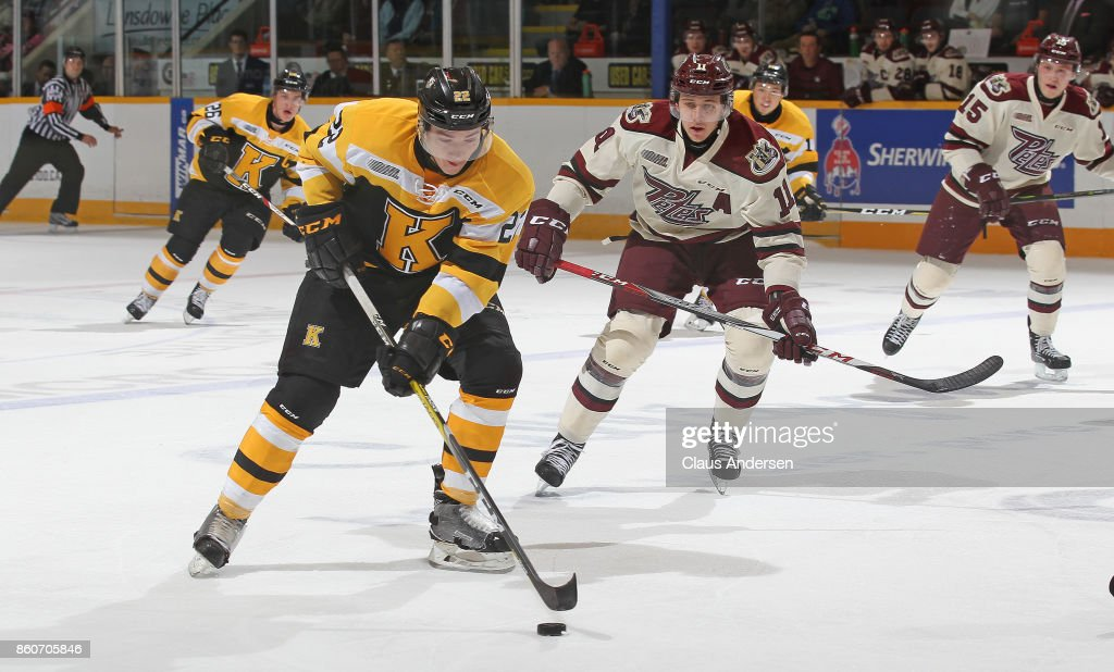 Jakob Brahaney #22 of the Kingston Frontenacs skates with the puck against Zach Gallant #11 of the Peterborough Petes in an OHL game at the Peterborough Memorial Centre on October 12, 2017 in Peterborough, Ontario.