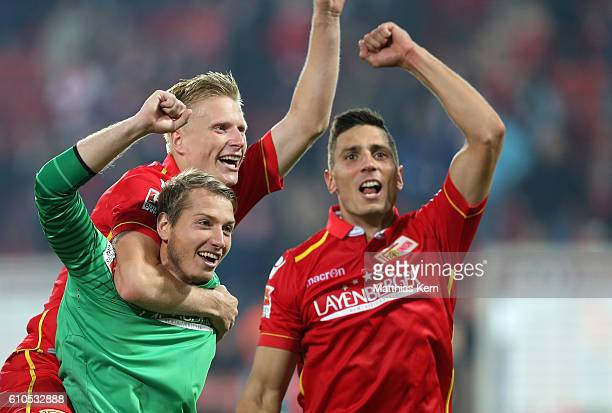 Jakob Busk Kristian Pedersen and Damir Kreilach of Berlin show their delight after winning the Second Bundesliga match between 1 FC Union Berlin and...