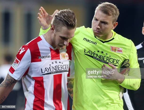 Jakob Busk of Berlin talks with team mate Sebastian Polter after the Second Bundesliga match between 1 FC Union Berlin and Eintracht Braunschweig at...