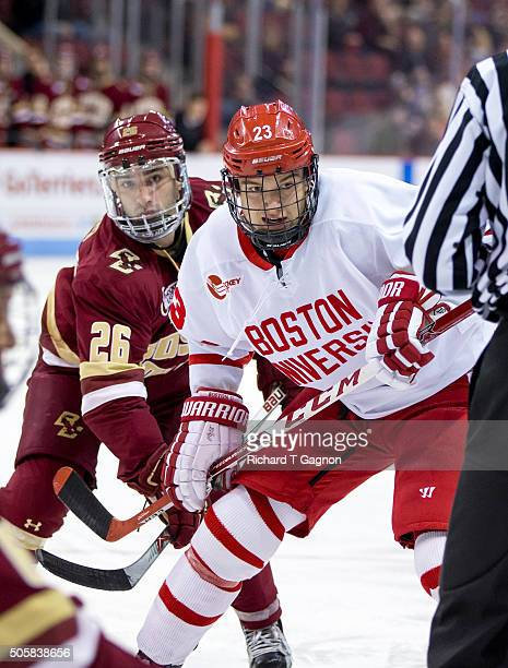Jakob Forsbacka Karlsson of the Boston University Terriers battles for position against Austin Cangelosi of the Boston College Eagles during NCAA...