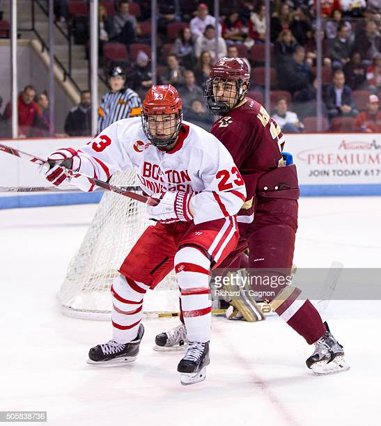 Jakob Forsbacka Karlsson of the Boston University Terriers battles for position against Ian McCoshen of the Boston College Eagles during NCAA hockey...