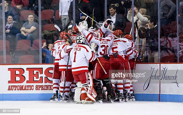Jakob Forsbacka Karlsson of the Boston University Terriers celebrates his overtime winning goal his third goal of the game against the Union College...