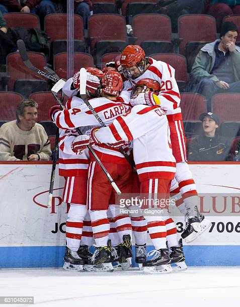 Jakob Forsbacka Karlsson of the Boston University Terriers celebrates his first of three goals against the Union College Dutchmen with his teammates...