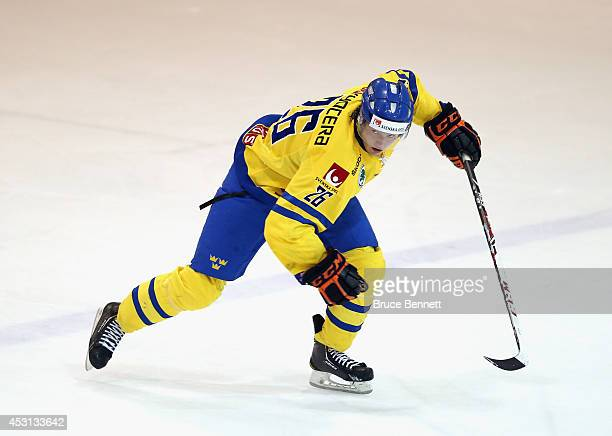 Jakob ForsbakaKarlsson of Team Sweden skates against USA White during the 2014 USA Hockey Junior Evaluation Camp at the Lake Placid Olympic Center on...