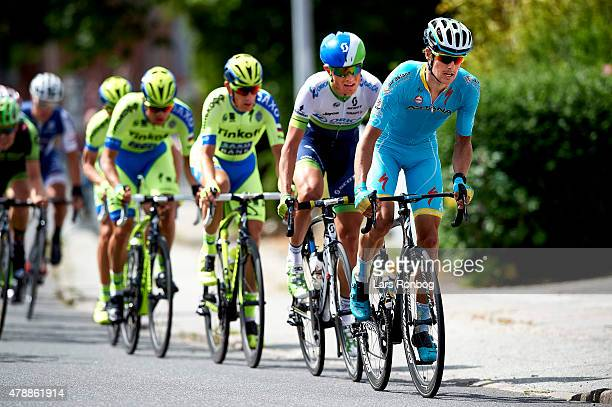 Jakob Fuglsang of Astana Pro Cycling leads a breakaway in front of Magnus Cort Nielsen of Orica Greenedge and Michael Morkov and Christopher Juul...