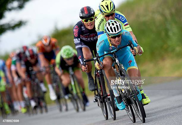 Jakob Fuglsang of Astana Pro Cycling leads a breakaway in front of Chris Anker Sorensen of Tinkoff Saxo during the Elite Mens Road Race during the...