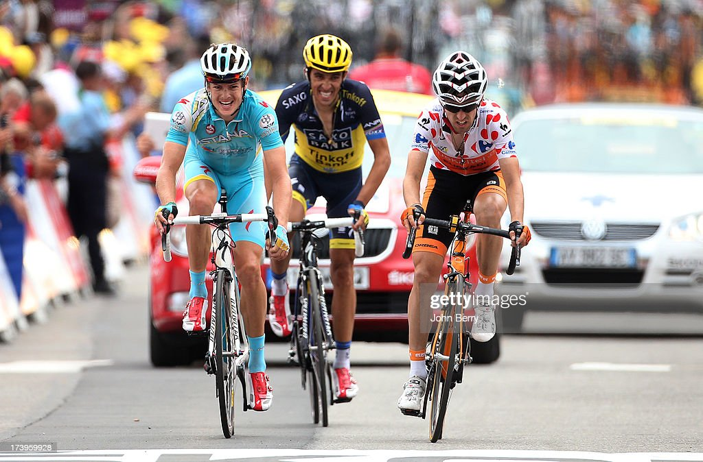 Jakob Fuglsang of Denmark and Astana Pro Team (L),Alberto Contador of Spain and Team Saxo-Tinkoff, best climber Mikel Nieve Iturralde of Spain and Team Euskaltel-Euskadi finish stage eighteen of the 2013 Tour de France, a 172.5KM road stage from Gap to l'Alpe d'Huez, on July 18, 2013 in Alpe d'Huez, France.
