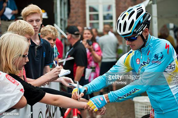 Jakob Fuglsang of Team Astana signing autographs for fans before before stage one of the Tour of Denmark between Hobro and Mariager on August 6 2014...