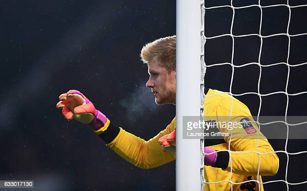 Jakob Haugaard of Wigan Athletic prganises his defence during the Emirates FA Cup Fourth round match between Manchester United and Wigan Athletic at...