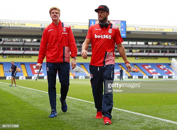 Jakob Haugard and Erik Pieters of Stoke City take a look around the pitch during the Premier League match between Crystal Palace and Stoke City at...