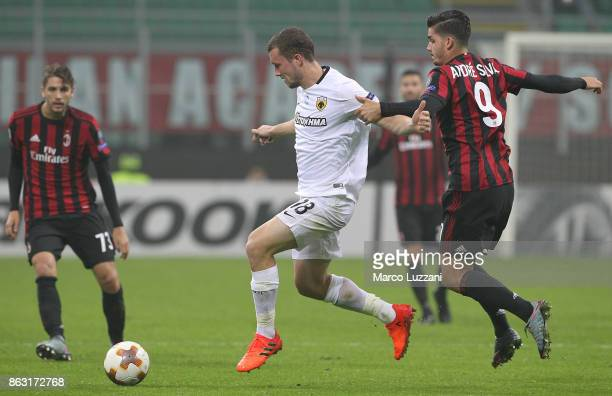 Jakob Johansson of AEK Athens is challenged by Andre Silva of AC Milan during the UEFA Europa League group D match between AC Milan and AEK Athens at...