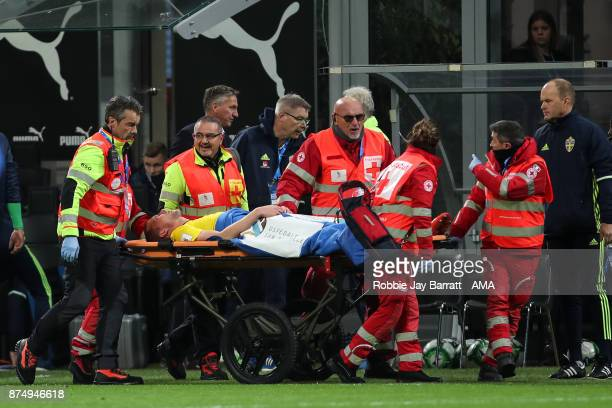 Jakob Johansson of Sweden goes off on a stretcher during the FIFA 2018 World Cup Qualifier PlayOff Second Leg between Italy and Sweden at San Siro...