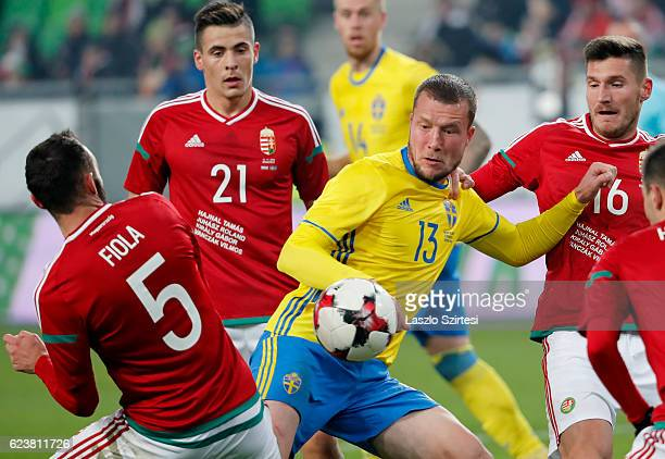 Jakob Johansson of Sweden tries to controls the ball among Attila Fiola of Hungary Zsombor Berecz of Hungary and Adam Pinter of Hungary during the...