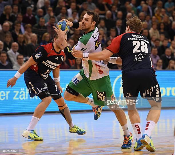 Jakob Macke of Flensburg challenges Tim Kneule of Goeppingen during the DKB Bundesliga handball match between SG FlensburgHandewitt and FA Goeppingen...