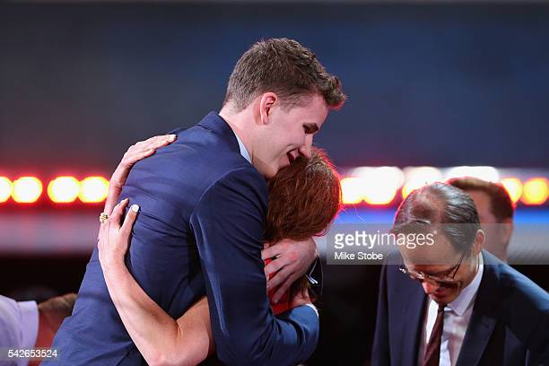 Jakob Poeltl celebrates with friends and family after being drafted ninth overall by the Toronto Raptors in the first round of the 2016 NBA Draft at...