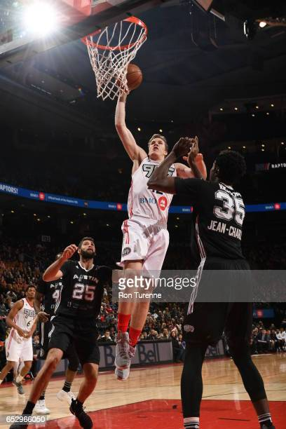 Jakob Poeltl of the Raptors 905 goes up for the jam over Livio JeanCharles of the Austin Spurs at the Air Canada Centre on March 13 2017 in Toronto...