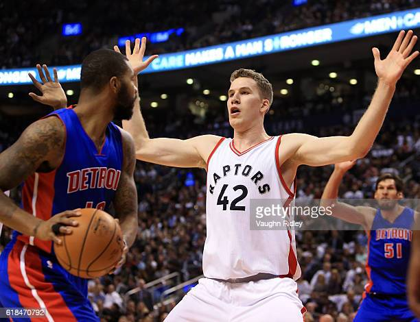 Jakob Poeltl of the Toronto Raptors defends during the first half of an NBA game against the Detroit Pistons at Air Canada Centre on October 26 2016...