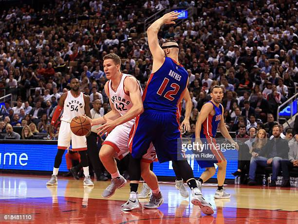 Jakob Poeltl of the Toronto Raptors dribbles the ball as Aron Baynes of the Detroit Pistons defends during the second half of an NBA game at Air...