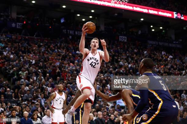 Jakob Poeltl of the Toronto Raptors drives to the basket against the Indiana Pacers on March 19 2017 at Air Canada Centre in Toronto Ontario Canada...