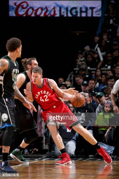 Jakob Poeltl of the Toronto Raptors drives to the basket against the Milwaukee Bucks during Game Three of the Eastern Conference Quarterfinals of the...