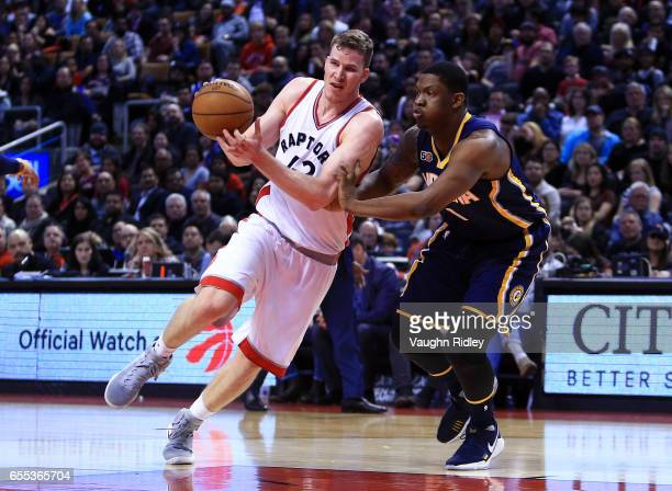 Jakob Poeltl of the Toronto Raptors drives to the basket as Kevin Seraphin of the Indiana Pacers defends during the second half of an NBA game at Air...