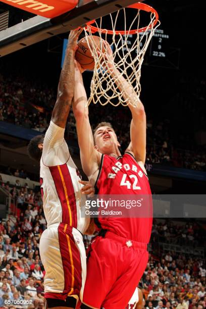 Jakob Poeltl of the Toronto Raptors goes for a lay up during the game against the Miami Heat on March 23 2017 at AmericanAirlines Arena in Miami...