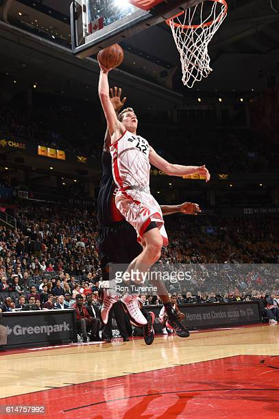 Jakob Poeltl of the Toronto Raptors goes to the basket against the San Lorenzo de Almagro during a preseason game on October 14 2016 at the Air...