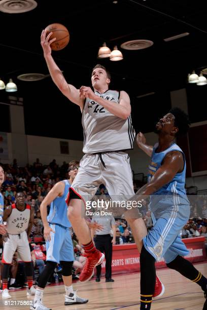 Jakob Poeltl of the Toronto Raptors goes to the basket against the Denver Nuggets during the 2017 Las Vegas Summer League on July 10 2017 at the Cox...