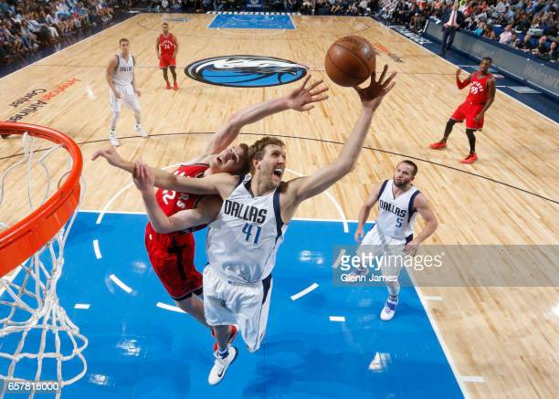 Jakob Poeltl of the Toronto Raptors goes up for a rebound against Dirk Nowitzki of the Dallas Mavericks on March 25 2017 at the American Airlines...