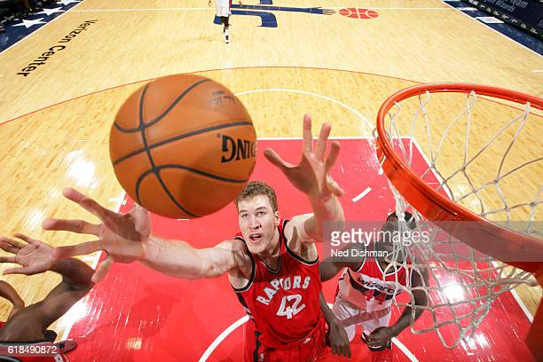 Jakob Poeltl of the Toronto Raptors goes up for a rebound during a preseason game against the Washington Wizards on October 21 2016 at Verizon Center...