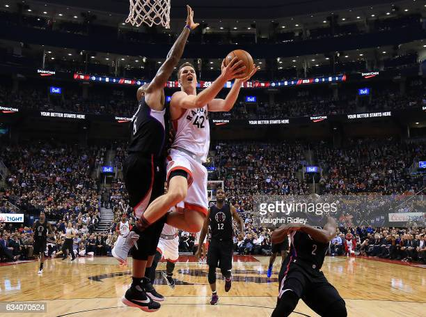 Jakob Poeltl of the Toronto Raptors goes up for a shot as Marreese Speights defends during the first half of an NBA game at Air Canada Centre on...