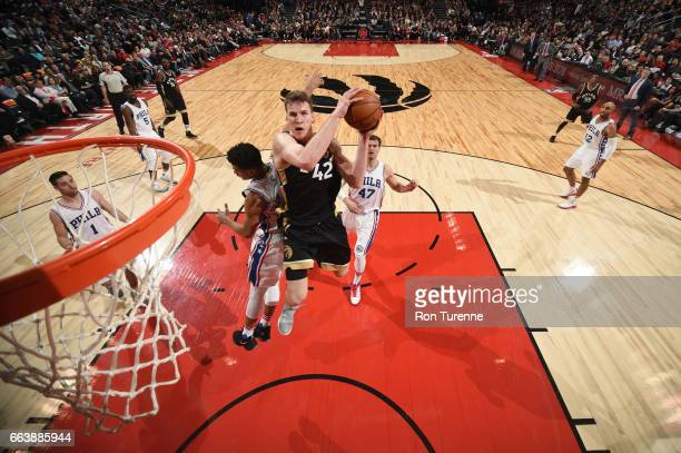 Jakob Poeltl of the Toronto Raptors goes up for a shot during a game against the Philadelphia 76ers on April 2 2017 at the Air Canada Centre in...