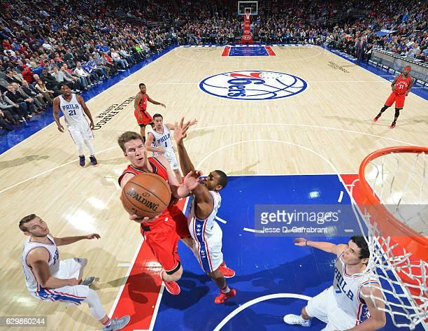 Jakob Poeltl of the Toronto Raptors goes up for the layup against the Philadelphia 76ers at Wells Fargo Center on December 14 2016 in Philadelphia...
