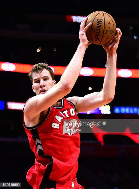 Jakob Poeltl of the Toronto Raptors grabs a rebound during a preseason game against the Los Angeles Clippers at Staples Center on October 5 2016 in...