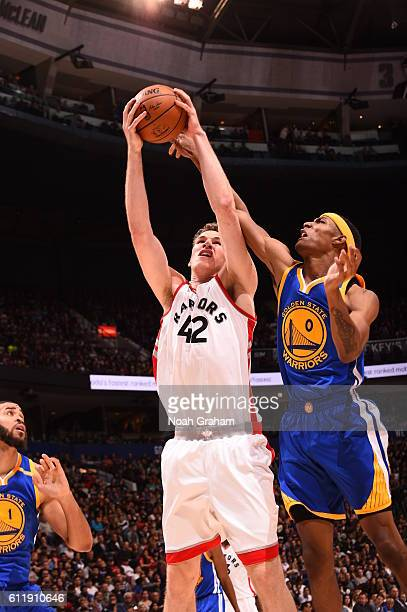 Jakob Poeltl of the Toronto Raptors grabs the rebound against Patrick McCaw of the Golden State Warriors during a preseason game on October 1 2016 at...