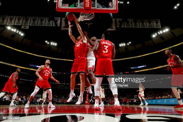 Jakob Poeltl of the Toronto Raptors grabs the rebound against the Chicago Bulls on October 13 2017 at the United Center in Chicago Illinois NOTE TO...