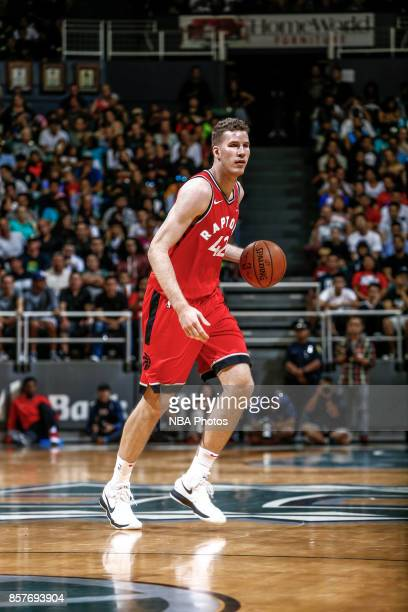 Jakob Poeltl of the Toronto Raptors handles the ball during the preseason game against the LA Clippers on October 4 2017 at the Stan Sheriff Center...