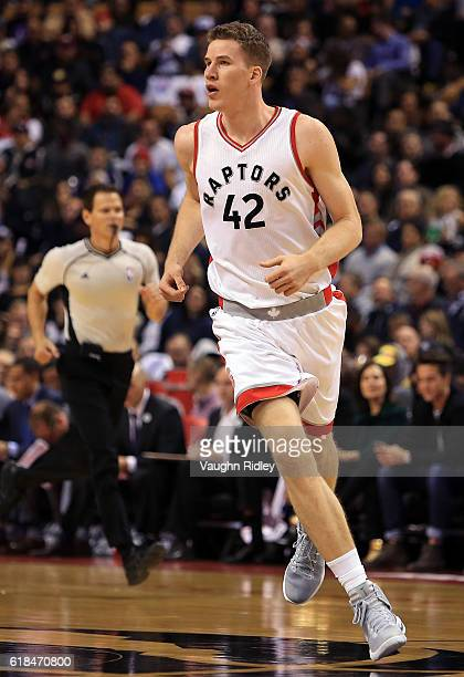 Jakob Poeltl of the Toronto Raptors runs down the court during the first half of an NBA game against the Detroit Pistons at Air Canada Centre on...