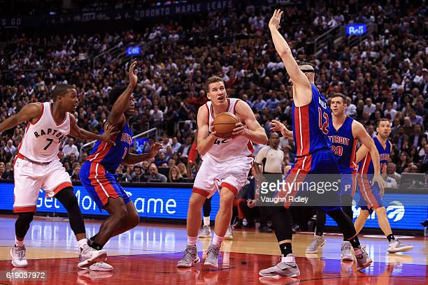 Jakob Poeltl of the Toronto Raptors shoots the ball as Aron Baynes of the Detroit Pistons defends during an NBA game at Air Canada Centre on October...