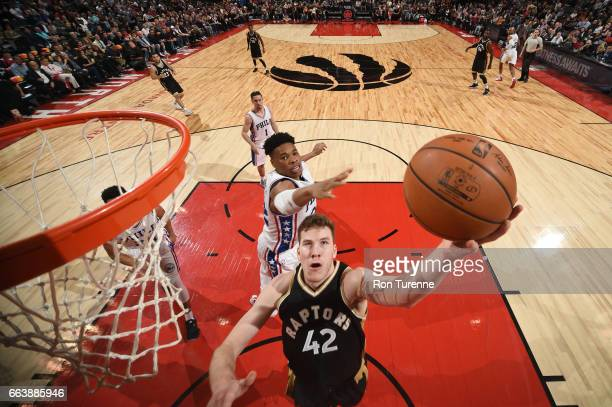 Jakob Poeltl of the Toronto Raptors shoots the ball during a game against the Philadelphia 76ers on April 2 2017 at the Air Canada Centre in Toronto...