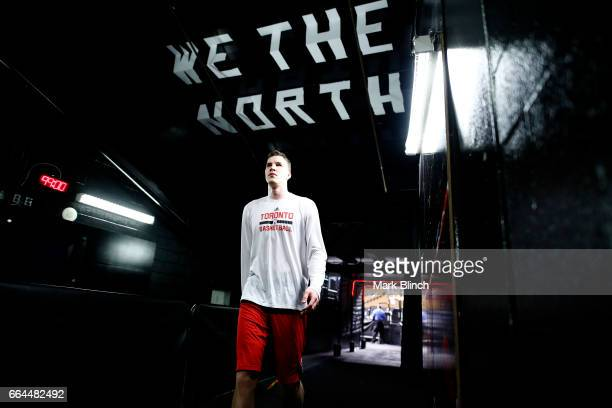Jakob Poeltl of the Toronto Raptors walks out to the court before the game against the Charlotte Hornets on March 29 2017 at the Air Canada Centre in...