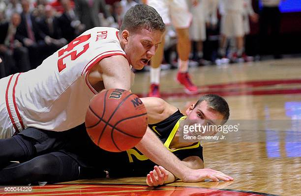 Jakob Poeltl of the Utah Utes and Casey Benson of the Oregon Ducks fight for the ball in the first half at the Jon M Huntsman Center on January 14...