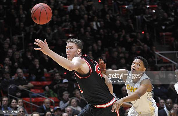 Jakob Poeltl of the Utah Utes and Ivan Rabb of the California Golden Bears try for the loose ball in the first half at the Jon M Huntsman Center on...