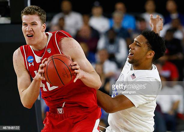 Jakob Poeltl of the Utah Utes and Jahlil Okafor of the Duke Blue Devils battle for a rebound in the first half during a South Regional Semifinal game...