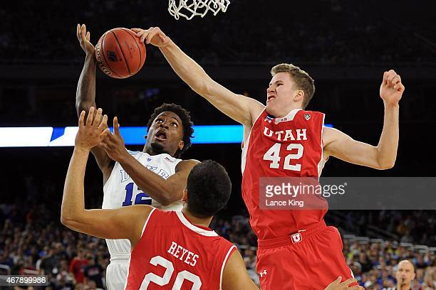 Jakob Poeltl of the Utah Utes defends a shot by Justise Winslow of the Duke Blue Devils during the South Regional Semifinal round of the 2015 NCAA...