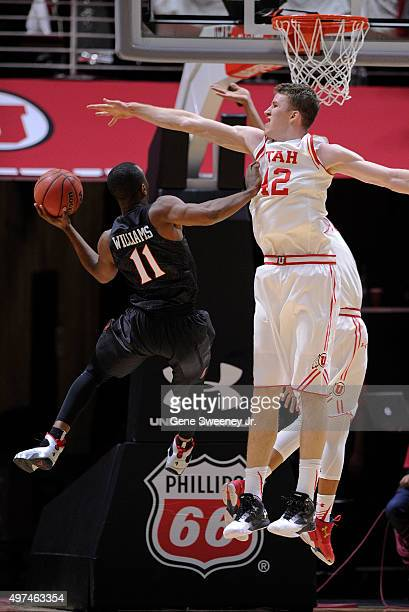 Jakob Poeltl of the Utah Utes defends against D'Erryl Williams of the San Diego State Aztecs in the second half of the 8176 win by Utah at the Jon M...