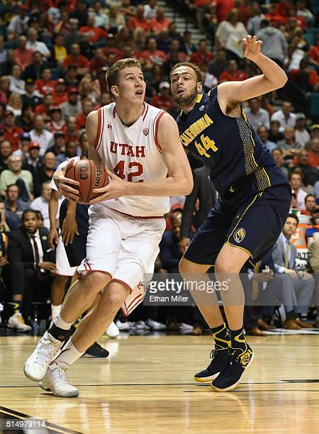 Jakob Poeltl of the Utah Utes drives against Kameron Rooks of the California Golden Bears during a semifinal game of the Pac12 Basketball Tournament...