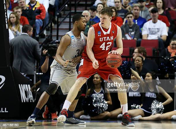 Jakob Poeltl of the Utah Utes drives against Mikael Hopkins of the Georgetown Hoyas in the first half during the third round of the 2015 NCAA Men's...